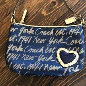 Coach navy blue small purse w/long gold Strap